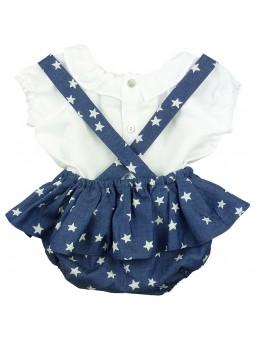 Paloma de la O. Conjunto camisa blanca y peto jeans estampado con estrellas vista trasera