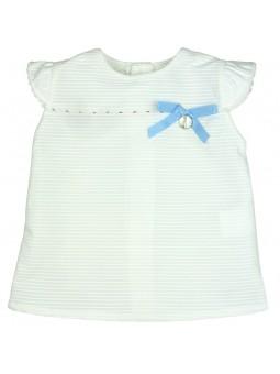 Rochy. Blusa blanca con lazo celeste