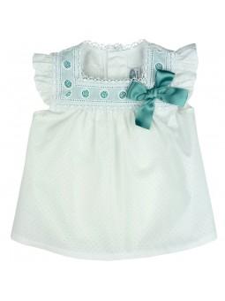 Rochy. Blusa blanca de bebé con lazo